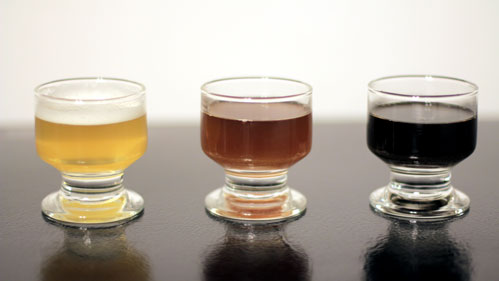 Three glasses of beer of different colors